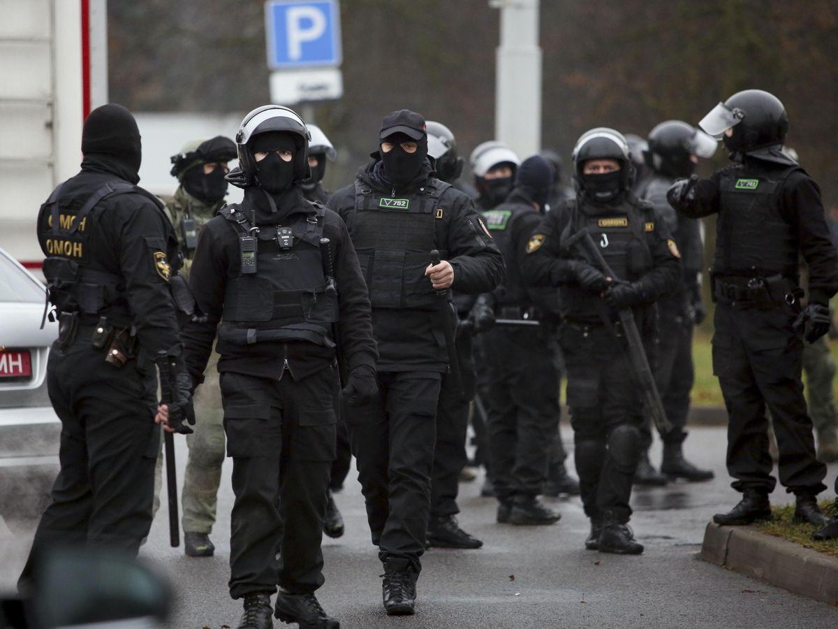 Belarusian riot police gather to block demonstrators