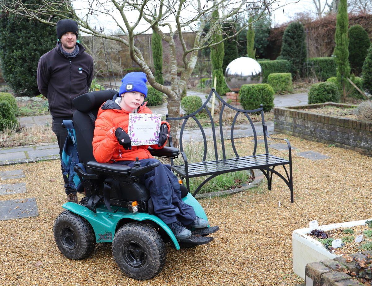 Horticultural student Oliver Burrows and teacher Will Lyon with the certificate