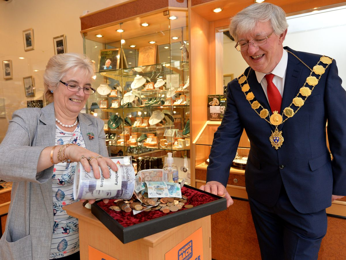E&J Jewellers owner Jeanette Sherry shows the money to mayor Phil Gillam