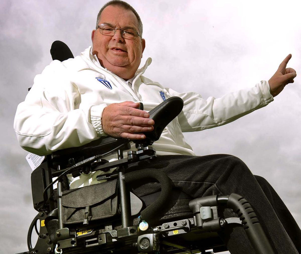 Shropshire cricket umpire John McIntear takes delivery of his unique electric wheelchair