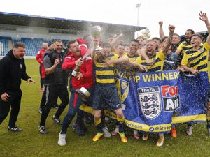 Shifnal Town players and coaching staff celebrate winning the Shropshire Senior Cup Pic: James Baylis