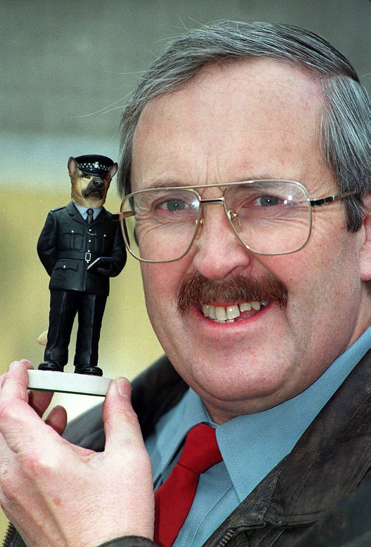 Ken Young with the model of his police dog, Karl
