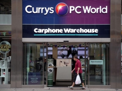 Dixons Carphone to cut costs after swinging to loss on mobile woes