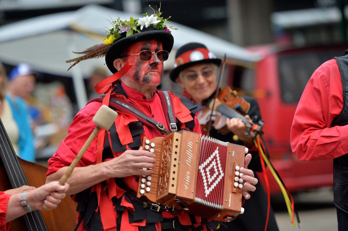 SHREW COPYRIGHT SHROPSHIRE STAR STEVE LEATH 25/07/2021..Pic in Shrewsbury Town Centre, where as part of the 'Miles of Smiles' event, there were various cultural events happening around the town. Here in the Square, The Ironmen and Severn Gildres perform..