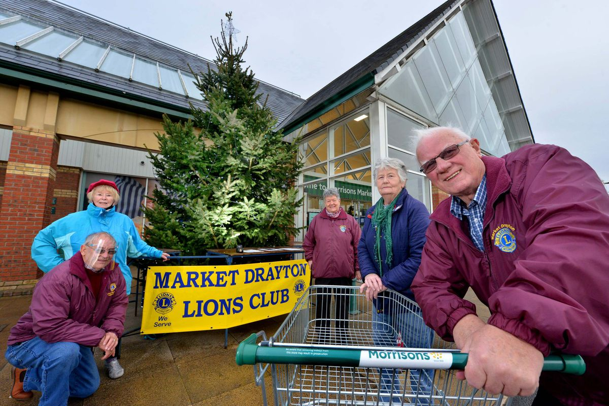 With this year's tree are, from left: Sheila Jackson and Olly Llewellyn, Chris Grundy, Ruth Glover and Lions Club president Jeff Murison