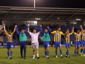 Steve Cotterill the head coach / manager of Shrewsbury Town and his players celebrate after winning the penalty shoot out.