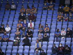 Shrewsbury Town supporters sitting in the stand.
