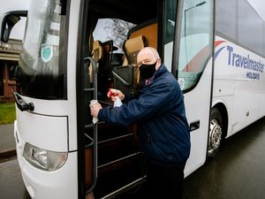 BORDER COPYRIGHT SHROPSHIRE STAR JAMIE RICKETTS 20/01/2021 - Owen's Coaches has seen a big surge in bookings for their coach holidays for this year after people have started having their vaccines. In Picture: Tour Driver Andy Evans cleaning the coaches..