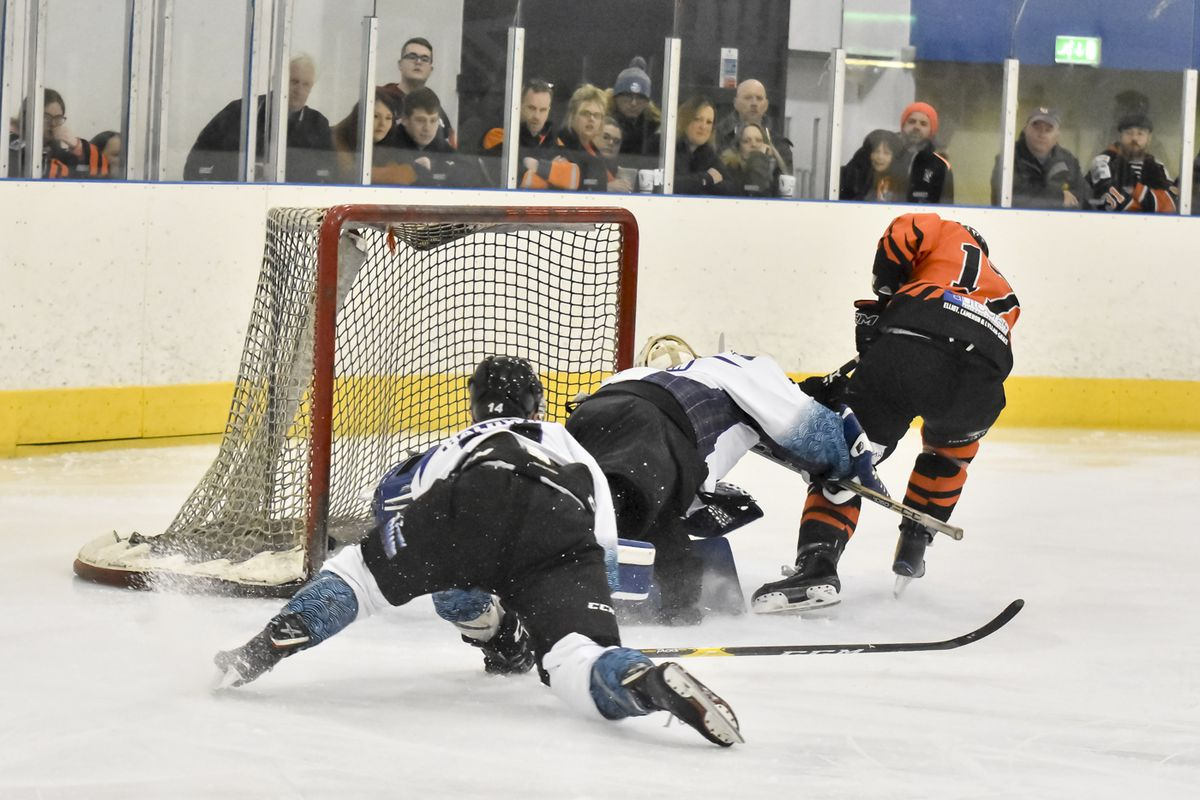 Ricky Plant Sneaks the puck under Solway's netminder
