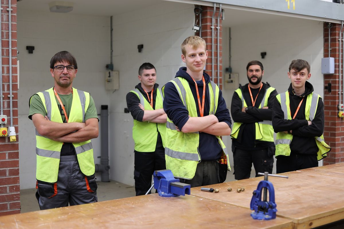 Some of the new electrical installation and maintenance apprentices in the Telford College workshops