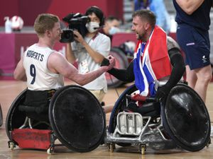Welshpool's Jim Roberts, left, and Stuart Robinson celebrate after winning the wheelchair rugby gold medal match against the U.S., at the Tokyo 2020 Paralympic Games in Tokyo. (AP Photo/Shuji Kajiyama)