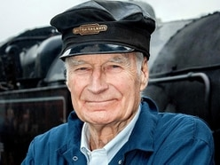 Star Peter steams in to see vintage railway carriage work for TV series