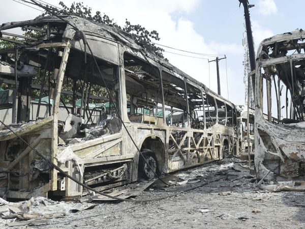 Burnt out government buses at the Berger station near Ikeja, Lagos (AP)