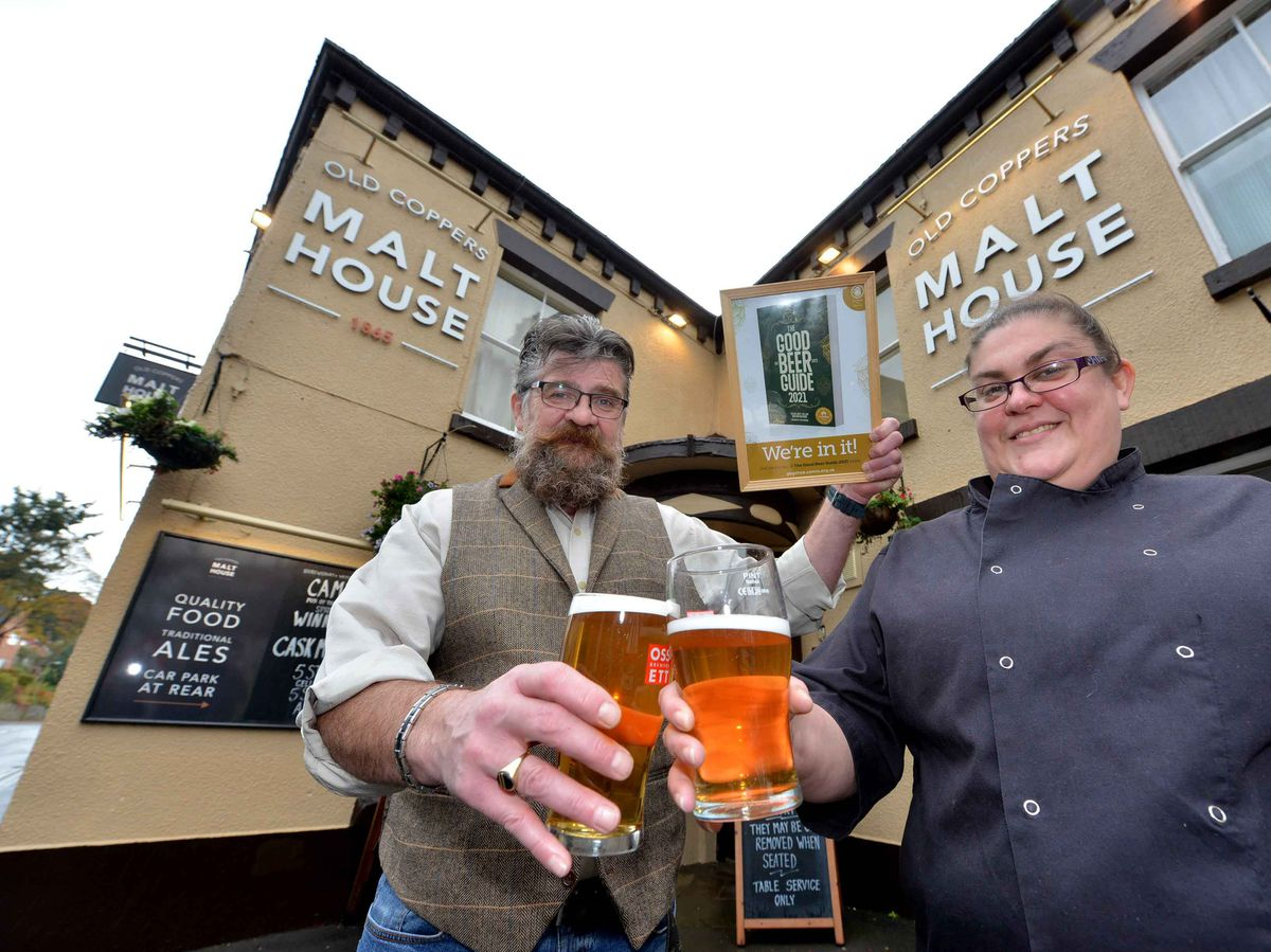 Heather Wheway and Philip Cole, at the Old Coppers Malt House, celebrate after getting into the Good Beer Guide