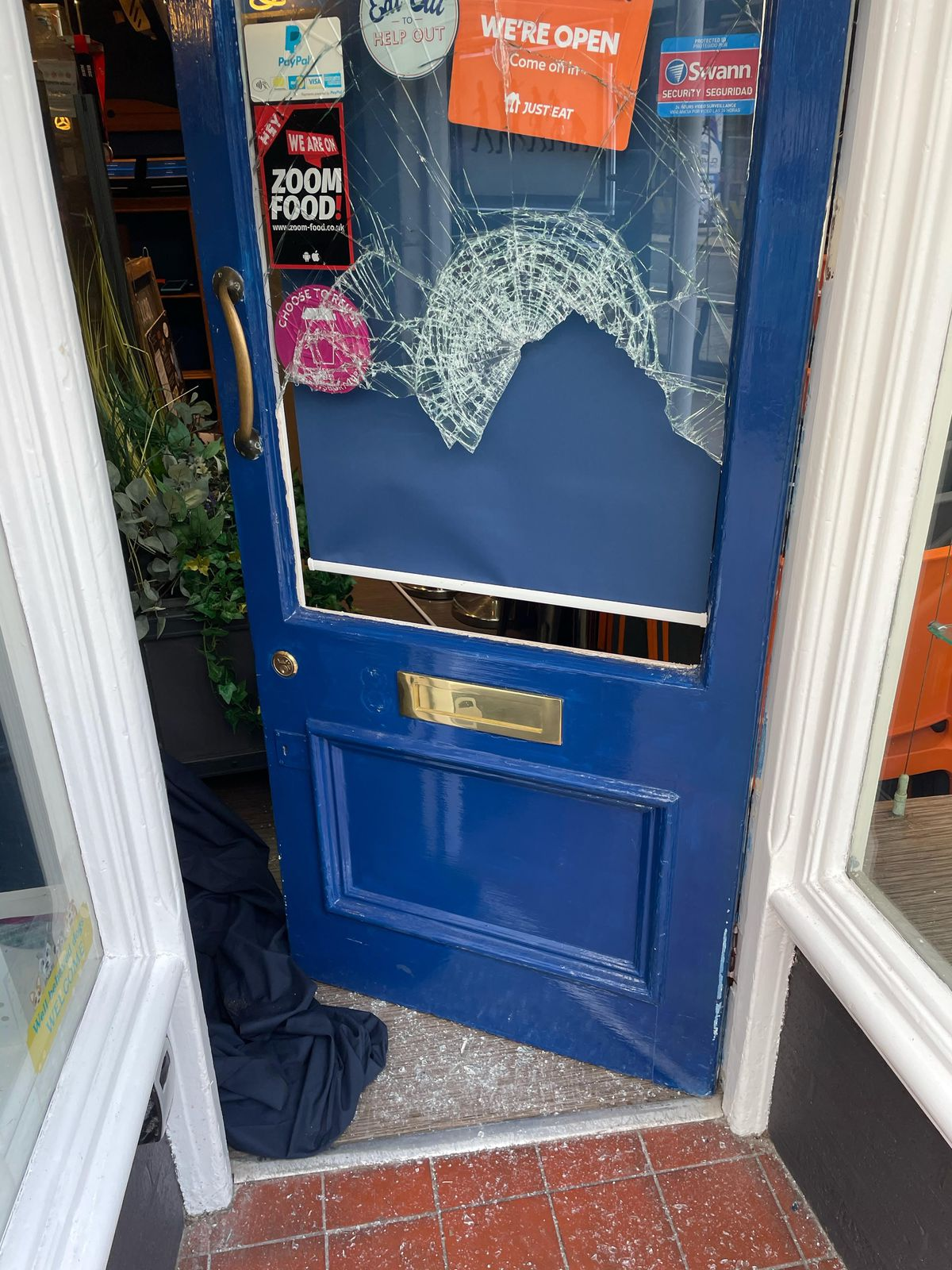 The door was smashed at Darwin's Sandwich Evolution