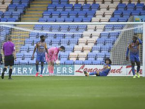 Dejected Shrewsbury Town players after Oliver Rathbone of Rochdale scored a goal (AMA)