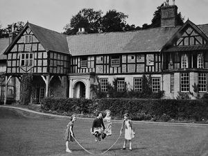 """nostalgia pic. Ludlow. This picture is a print from the Express and Star picture archive. The caption pasted on the back reads: 'The peaceful scene of 16th century Ludford House, Ludlow, will be interrupted tomorrow and Thursday, when antique collectors and dealers from all over the country will gather there for the two-day sale of the furnishings. The home of the late Mr Henry Whitaker (CORRECT), a former High Sheriff of Shropshire, the entire estate has been sold to a property company. It is expected that the estate will be divided and resold in the late autumn."""" Date stamp: August 27, 1957. Copyright stamp: None. Written date on back of print is August 19, 1957: Photographer: John Rea. Grand house. Grand mansion. Mansions. Library code: Ludlow nostalgia 2012."""