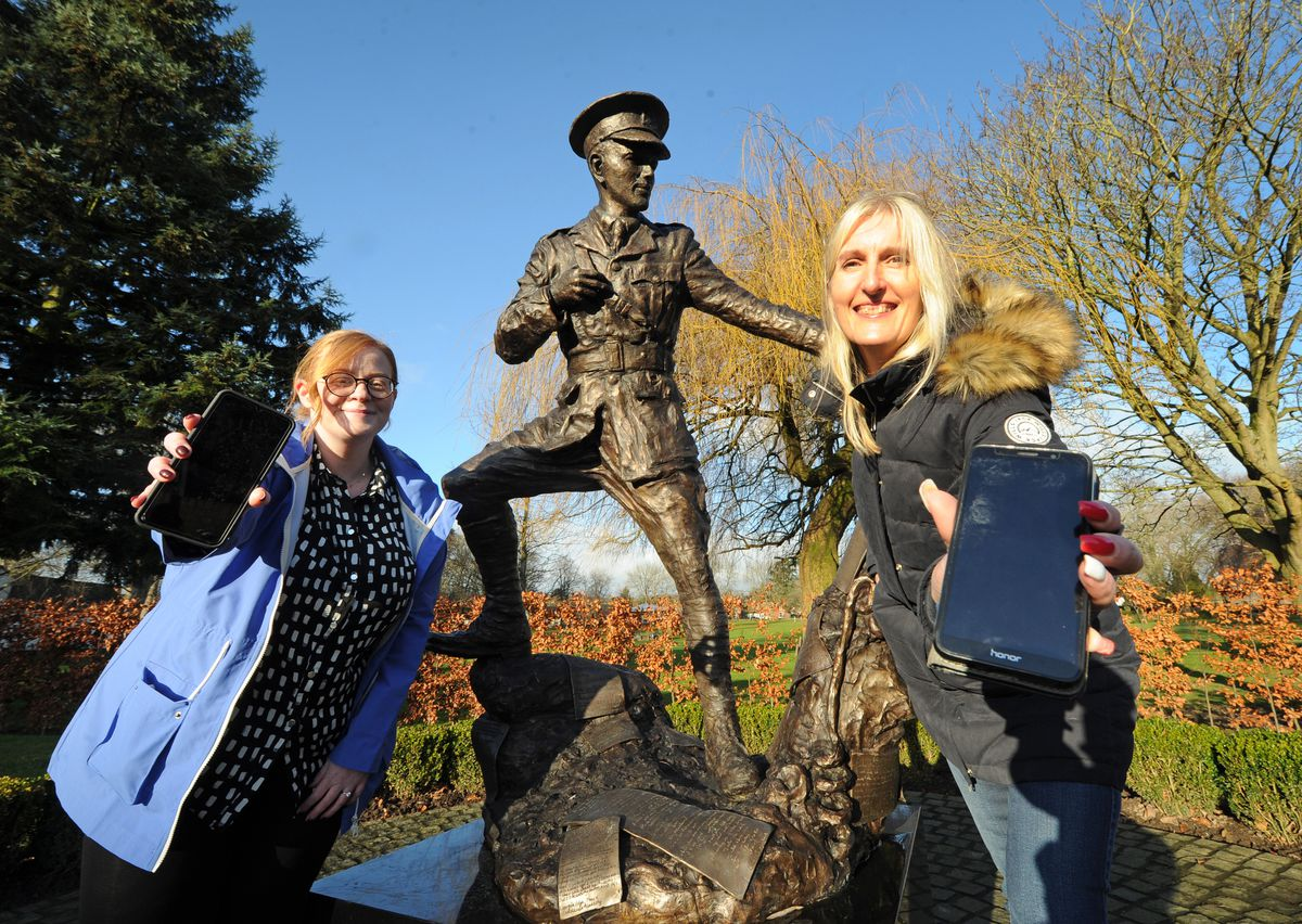 Oswestry BID administrator Lindsey Pierce, and Oswestry BID manager Adele Nightingale, at Cae Glas Park, Oswestry with the Wilfred Owen Sculpture