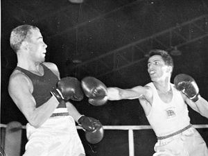 Tommy Nicholls, right, in the final at the 1956 Olympic Games at Melbourne, where he missed out on the gold in a split decision, coming home with a silver medal