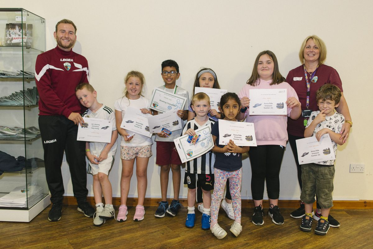 Matt Lee and Shelly McGlinchey from The Venue and The New Saints FC Foundation with children who attended the holiday club