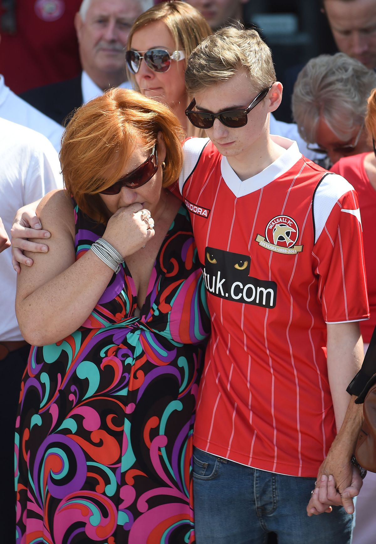 Owen comforts his mother at the Banks's Stadium days after the attack