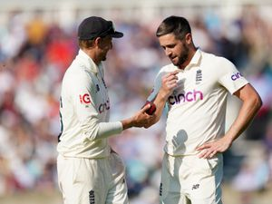 England's Joe Root (left) and Chris Woakes during day four of the cinch Fourth Test at the Kia Oval, London. Picture date: Sunday September 5, 2021. PA Photo. See PA story CRICKET England. Photo credit should read: Adam Davy/PA Wire.    RESTRICTIONS: Editorial use only. No commercial use  without prior written consent of the ECB. Still image use only. No moving images to emulate broadcast. No removing or obscuring of sponsor logos.