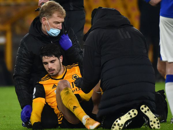"""Wolverhampton Wanderers' Pedro Neto receives medical treatment during the Premier League match at Molineux Stadium, Wolverhampton. PA Photo. Picture date: Tuesday January 12, 2021. See PA story SOCCER Wolves. Photo credit should read: Rui Vieira/PA Wire. RESTRICTIONS: EDITORIAL USE ONLY No use with unauthorised audio, video, data, fixture lists, club/league logos or """"live"""" services. Online in-match use limited to 120 images, no video emulation. No use in betting, games or single club/league/player publications."""