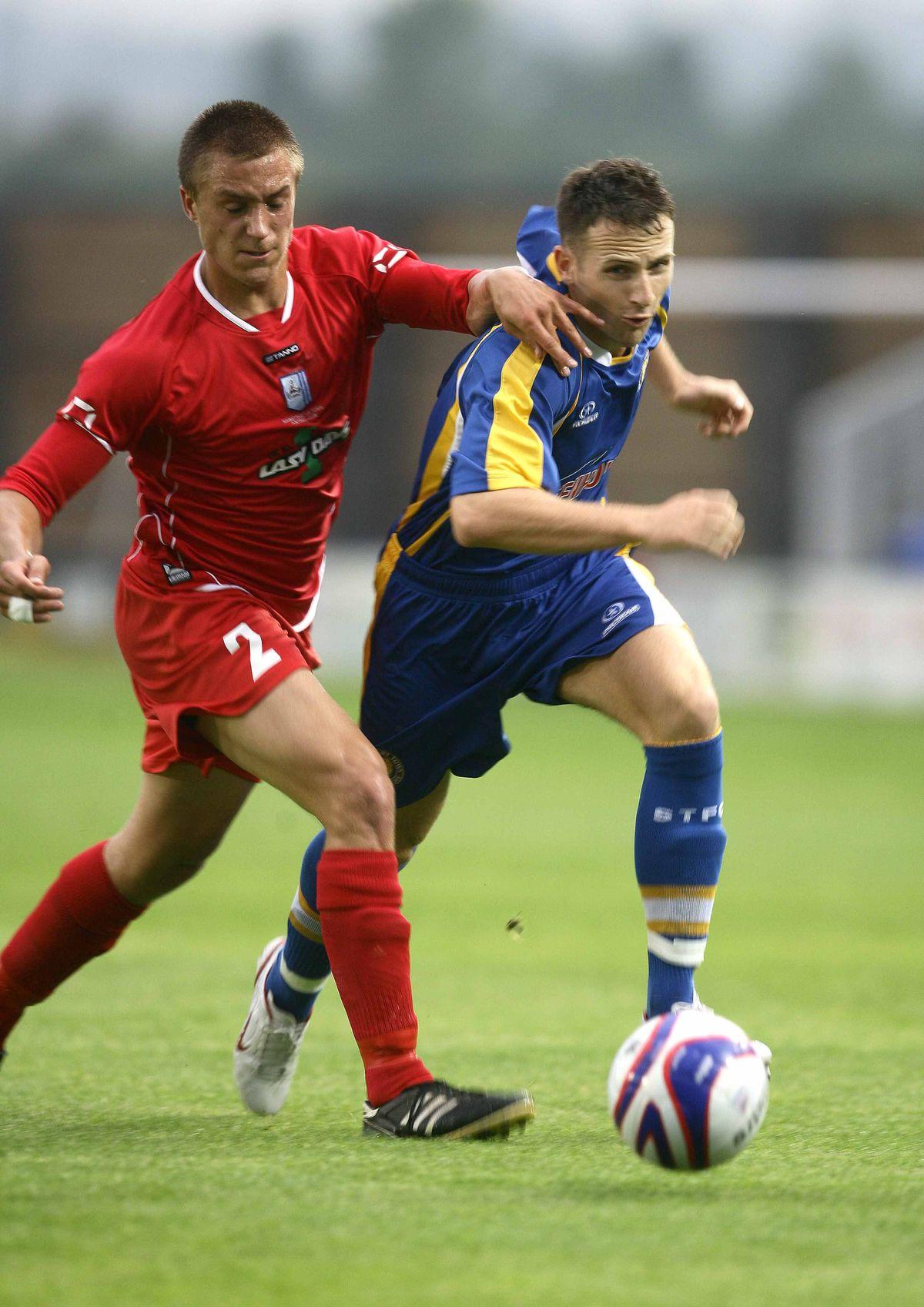 Shrewsbury Town v Market Drayton, Shropshire Senior Cup Marc Pugh takes on Drayton full-back Jason Francis