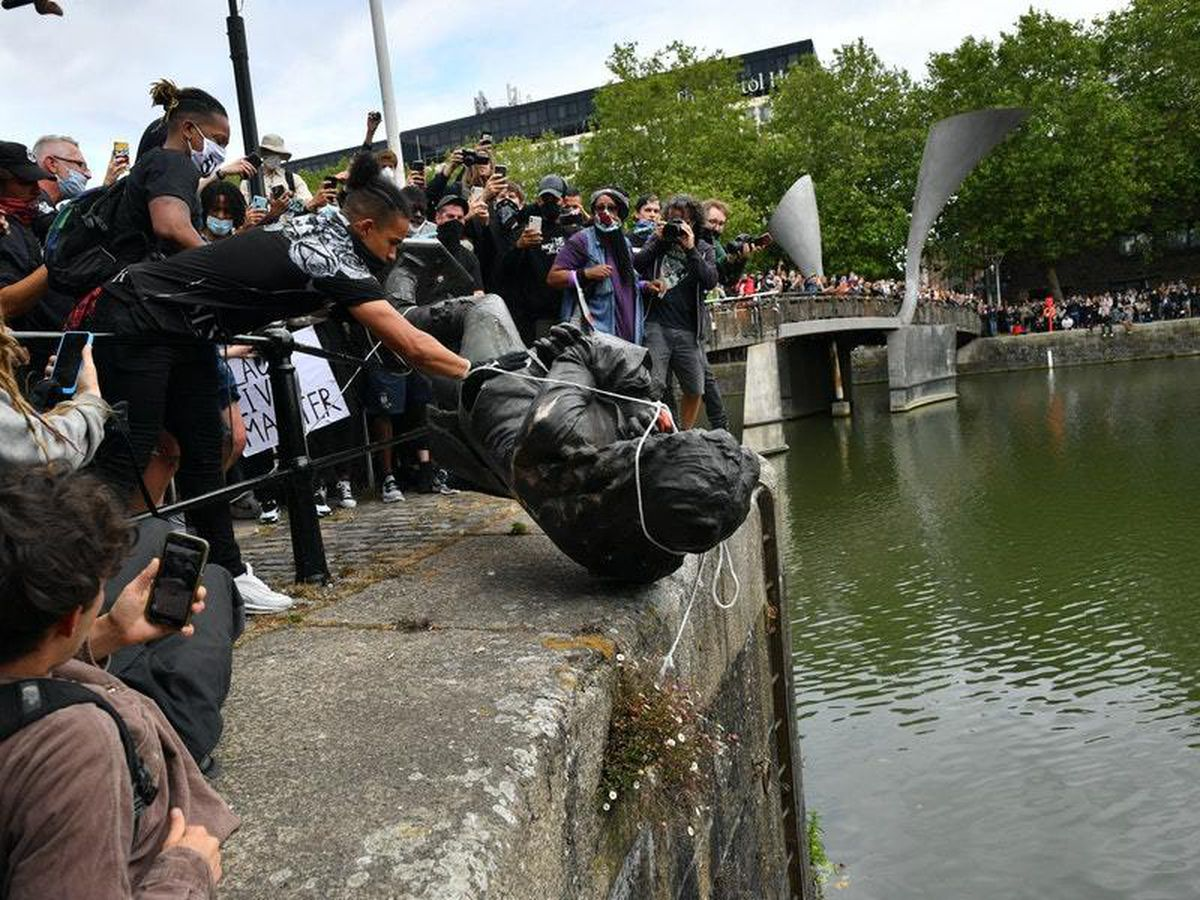 Colston's statue is pushed into the harbour in Bristol
