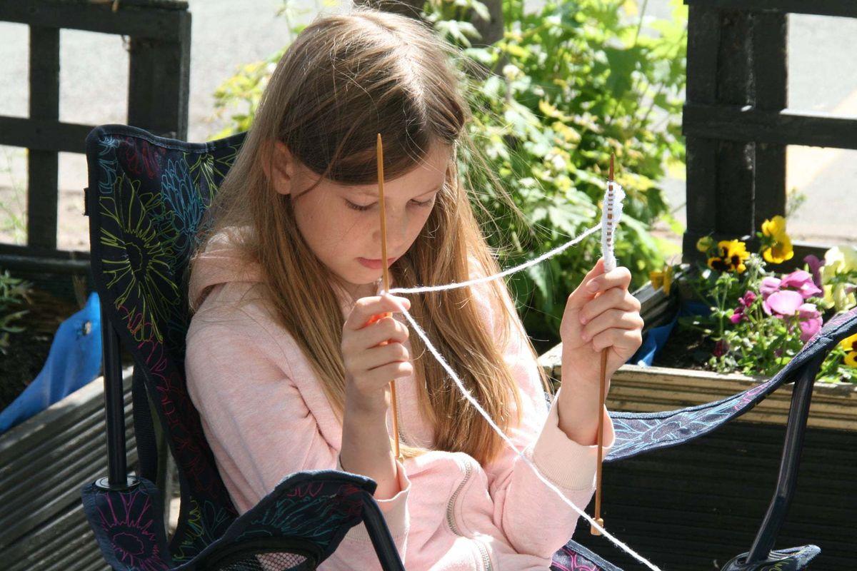 Catrin Utting, nine, starts her knitting