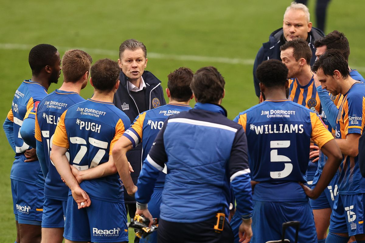 Steve Cotterill the head coach / manager of Shrewsbury Town talks to his players ahead of extra time. (AMA)
