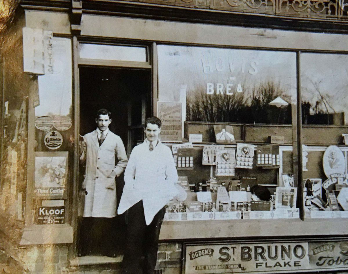 David's father pictured left, outside the William Webb salon in Wednesfield