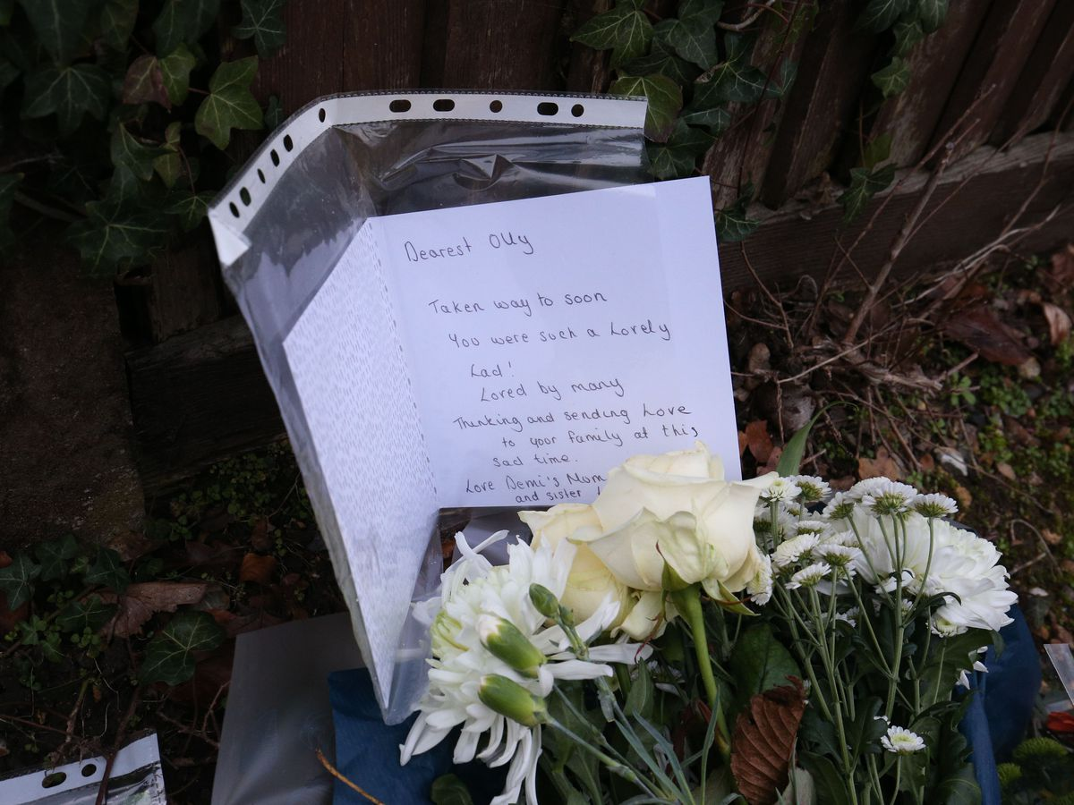 Floral tributes and a card left outside Highdown School in Reading