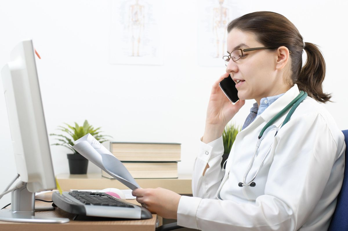 A generic stock photo of a female doctor looking at test results.