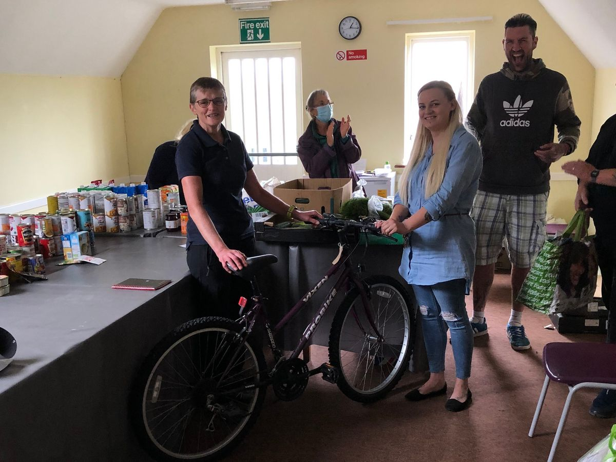 Janet Marsden from Ludlow Synergy Bike Hub presents a bike to Kerry Powell