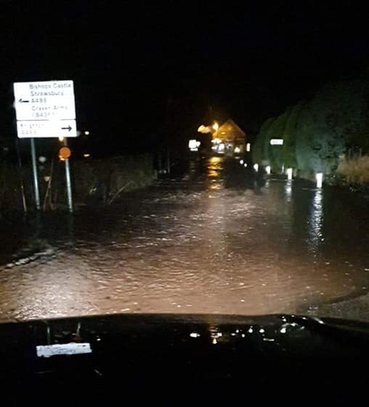 Storm Dennis flooding on the B4368 near Clun Bridge. Photo: Nicola Owen