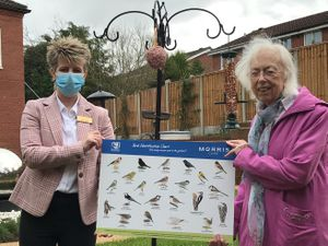 Shrewsbury's Radbrook Nursing Home general manager, Jo Bennett, and resident Sybil Williams with the bird feeders and identification boards, donated by CJ Wildlife
