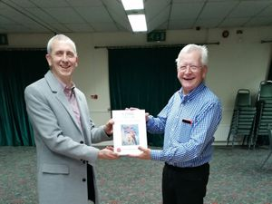 Deryn Poppit and Mike McKenna with the book