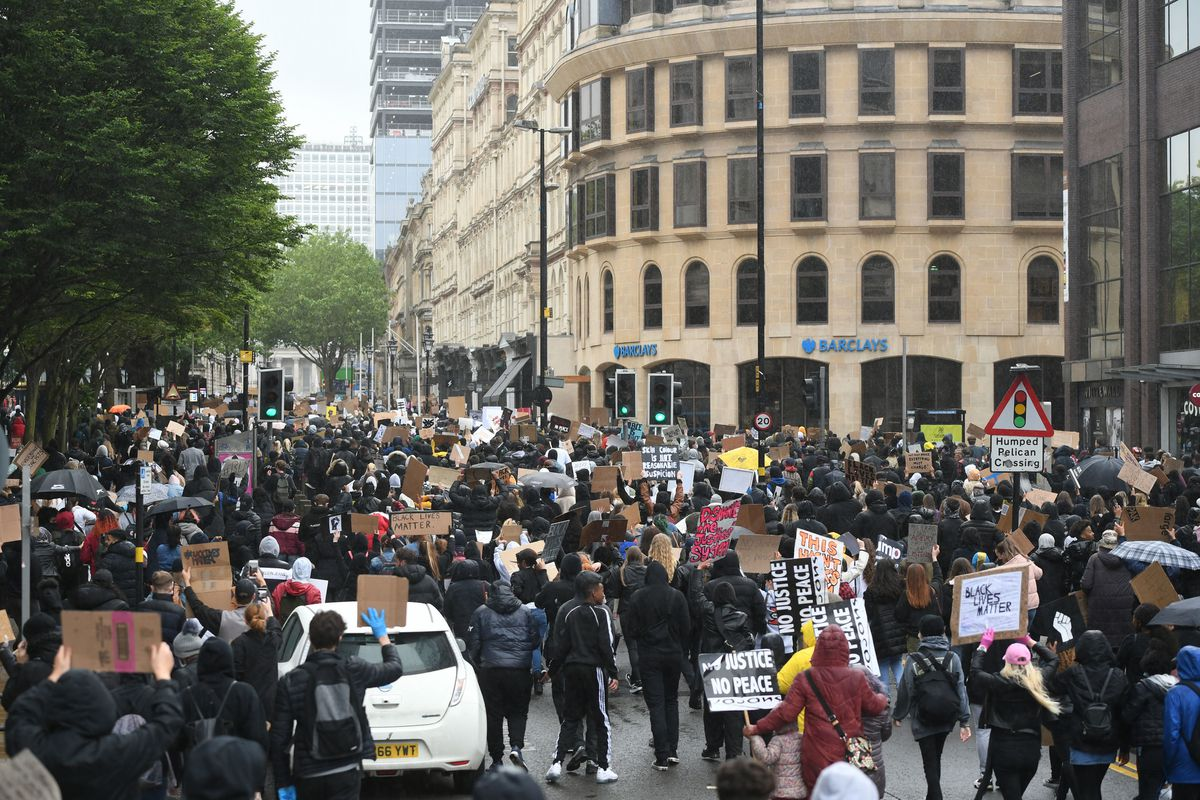 People marching down Colmore Row during a Black Lives Matter protest rally