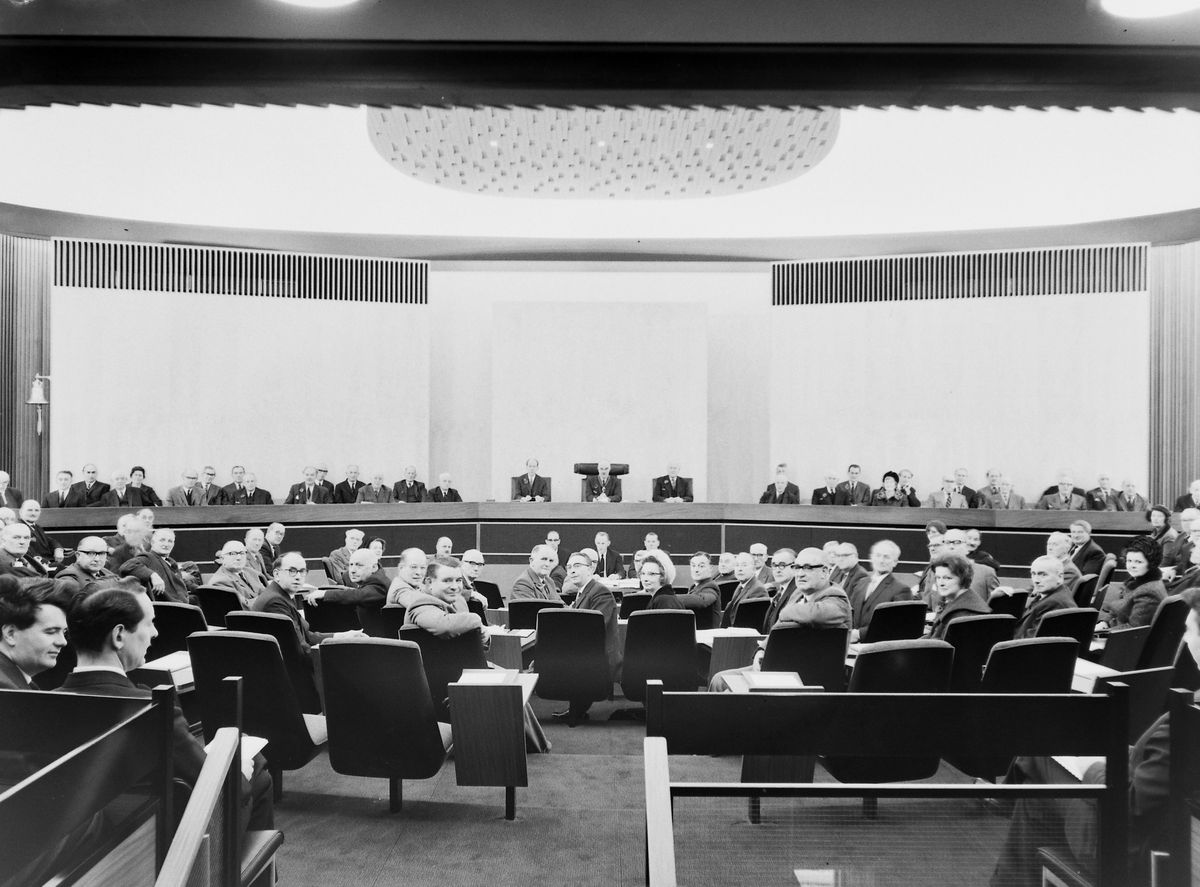 According to veteran photographer Bernard Cross this shows the first council meeting held at the new venue.