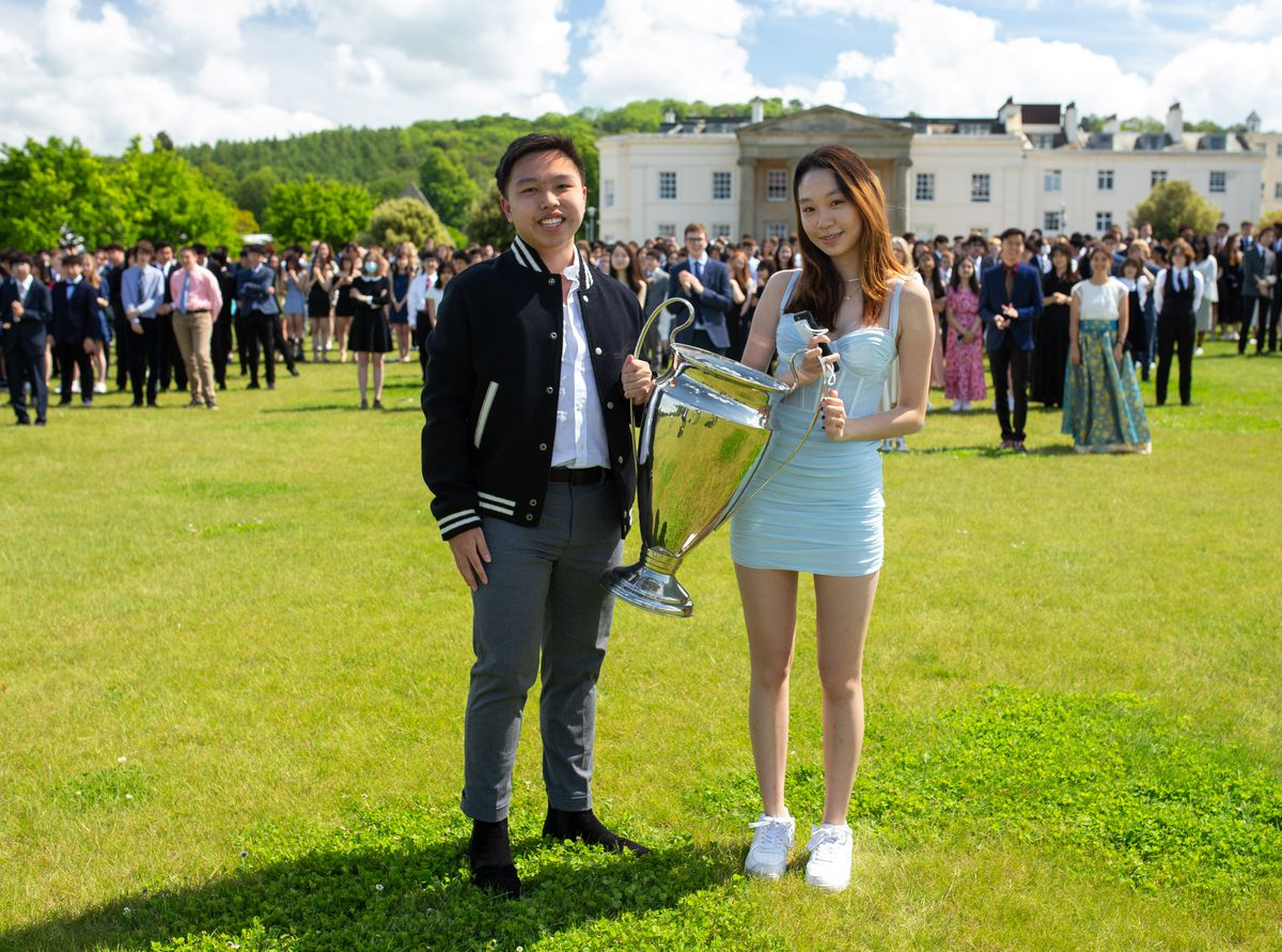 Teresa House captains with the house cup on school photo day, left to right Fabian Yiu, 19, and Joy Kwek, 17