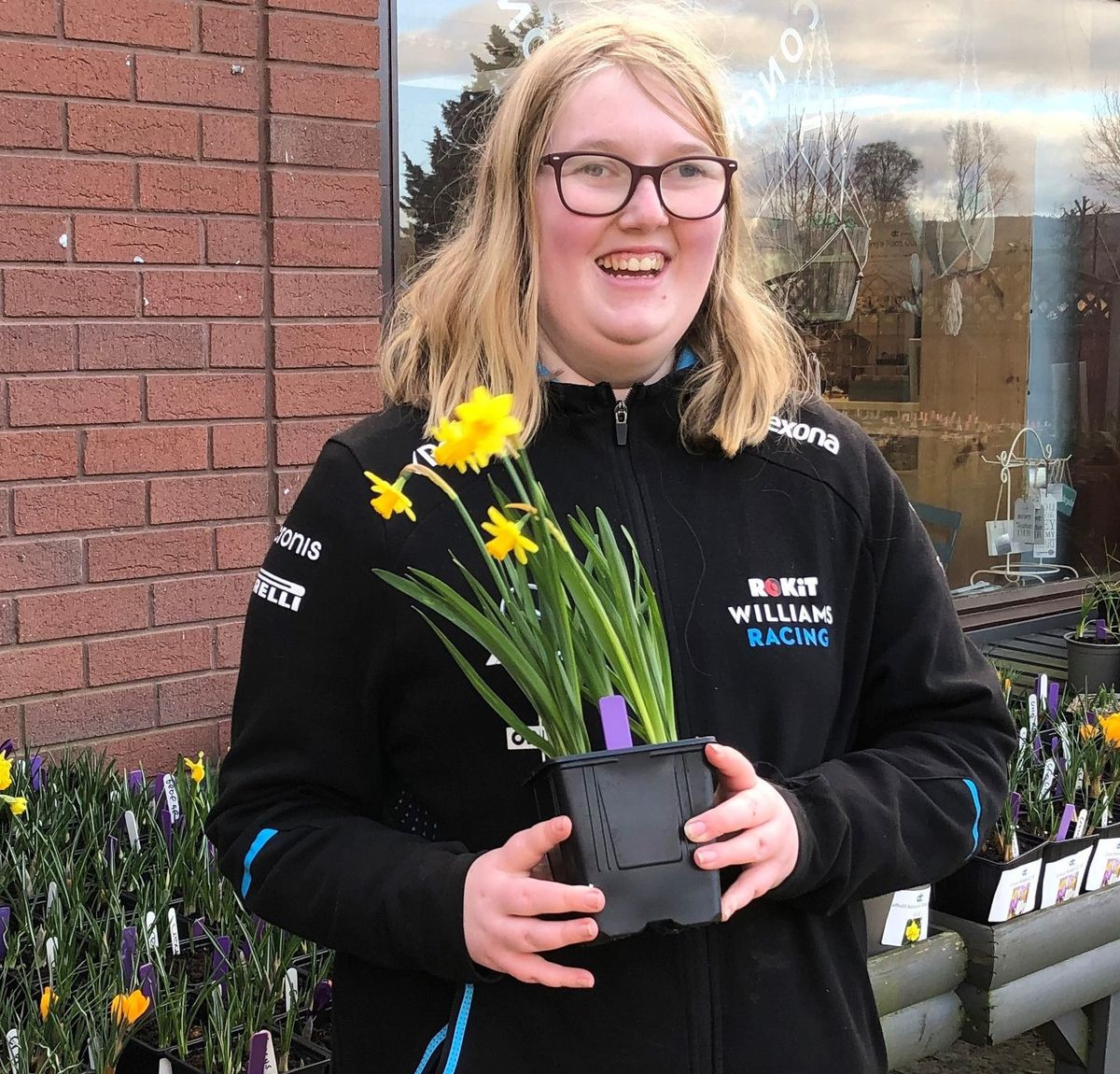 Horticultural student at Derwen college, Sophie preparing for the re-opening of the garden centre
