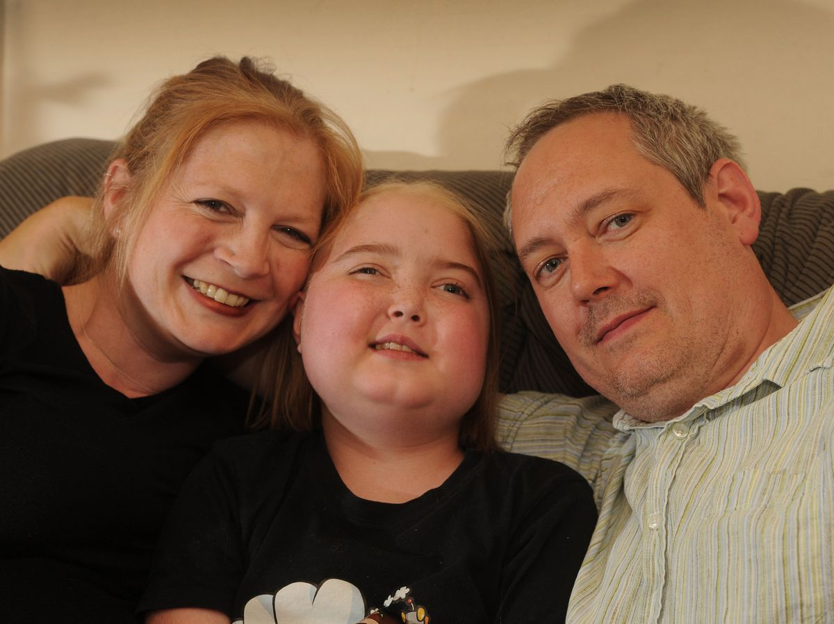 At home, Cleo Postlethwaite, aged 10, with her parents Jane and Alex