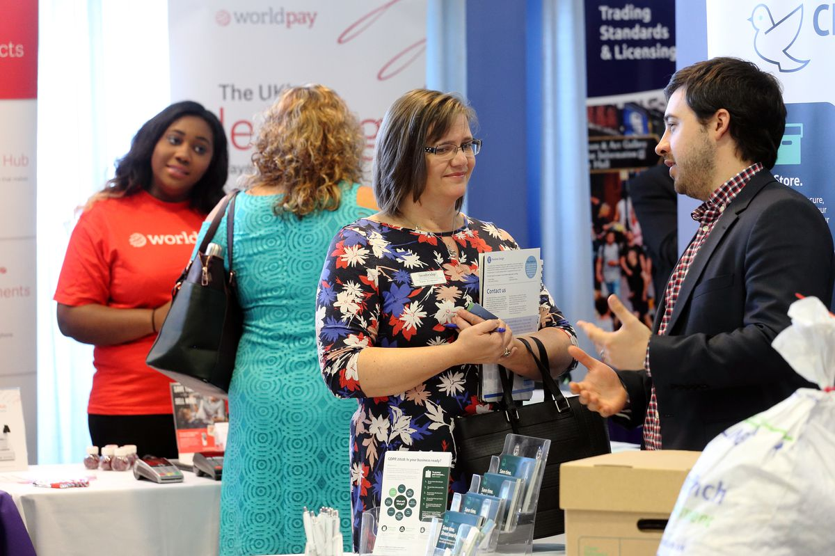 Exhibitors and guests mingle at the expo