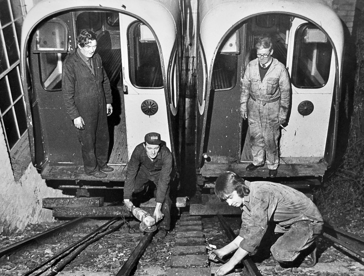 Maintenance work was taking place at Bridgnorth Cliff Railway in January 1973. The maintenance engineers working on the track and carriages are from left, Arthur Unit, John Murphy, Martin Simpson, and Arthur Nettleton.