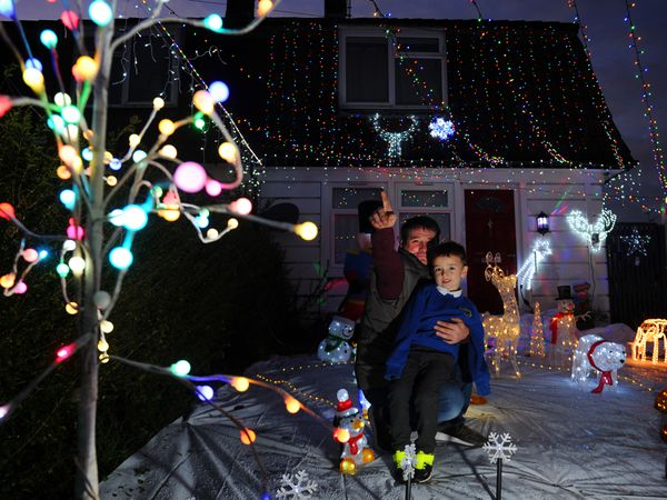Looking at the Christmas lights outside their home, Matthew Evans and Jack-Charles Evans, aged 5, of West Place, Gobowen..