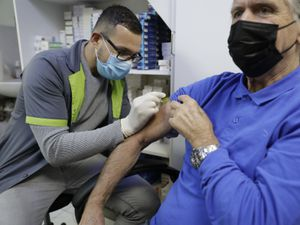 A vaccination taking place.