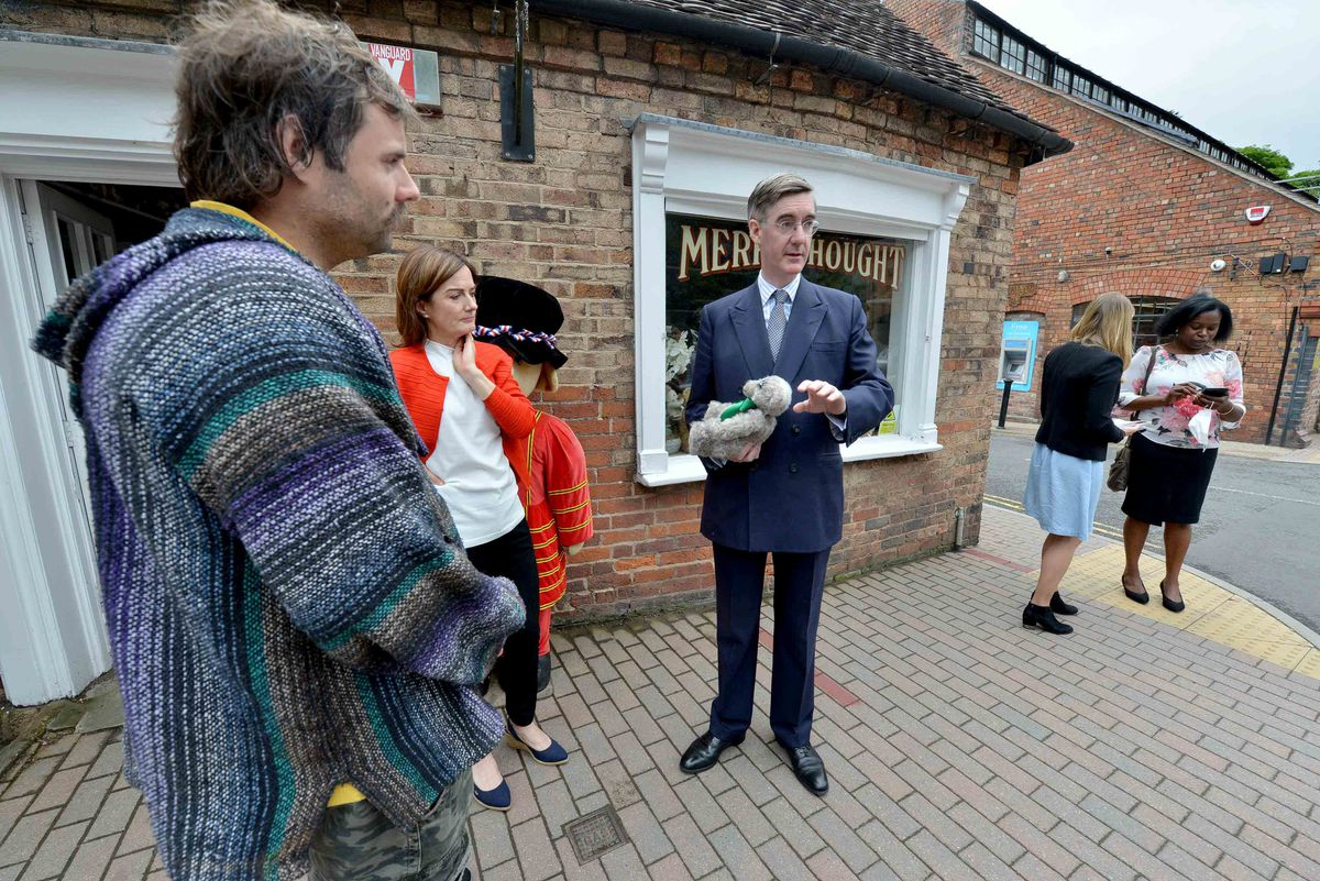 Charlie Parker, left, during Jacob Rees-Mogg's visit to Ironbridge