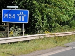 Casualty cut from car which crashed up verge on M54