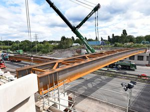 The new beam lifted into place at Junction 10
